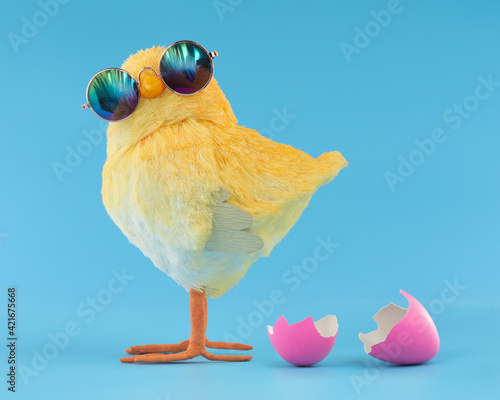 Tela Easter decoration of a yellow chick wearing silly sunglasses with a pink cracked, hatched Easter egg