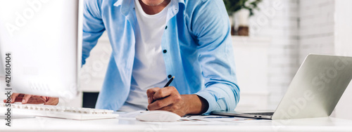 Young smiling asian man using laptop computer working and video conference online meeting with colleagues at home.Young creative man talk video call with business team.work from home concept