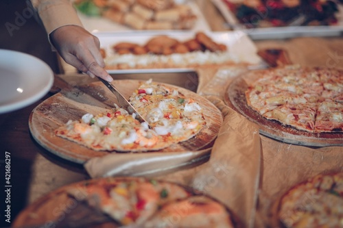 Fototapeta Close-up Of Hand Holding Pizza obraz