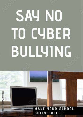 Digitally generated image of say no to cyber bullying text against laptop on grey background