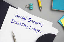 Juridical Concept Meaning Social Security Disability Lawyer With Sign On The Sheet.