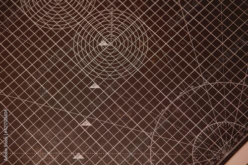 Fototapeta Closeup shot of a professional cutting mat with measuring scales