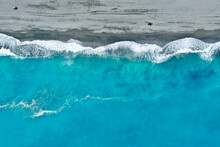 Aerial View Of Waves Rushing Towards Shore