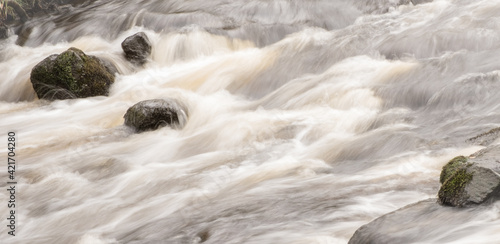 Scenic View Of Fast Flowing River Wallpaper Mural