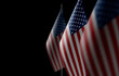 Small national flags of the United States on a black background