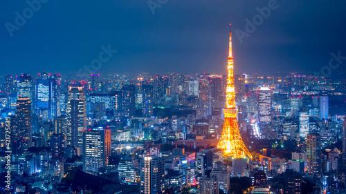 Obraz na plátně Illuminated Cityscape Against Sky At Night