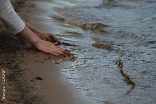 Obraz Midsection Of Woman At Beach - fototapety do salonu