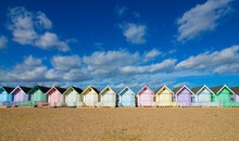 Beach Huts Against Buildings Against Sky