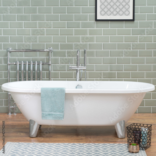 Papel de parede Bathtub in a bathroom with laminate flooring and ceramic tiled wall, a loft styl