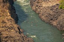 White Water Rafting On Zambezi River Nearby The Victoria Falls In Between Zimbabwe And Zambia.