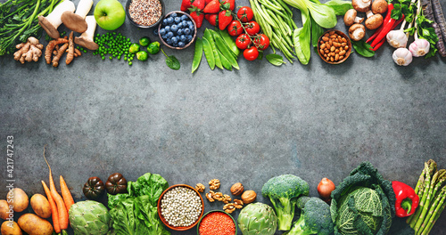 Healthy food selection with fruits, vegetables, seeds, superfood and cereals Fotobehang