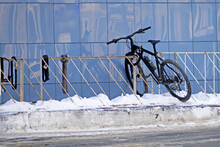 Winter View Of The Bicycle Parking Lot Near The Wall Of The House Finished With Glazed Tiles