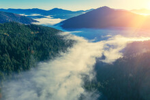 Fantastic View Of The Tops Of The Mountain Ridge Above The Clouds At Sunrise