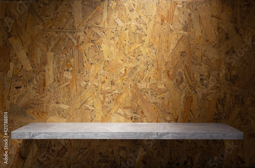 Wooden shelf and osb wood background of wall texture. Book shelf at chipboard background