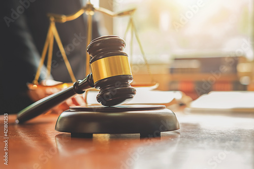 Fototapeta Midsection Of Judge Working At Desk With Gavel And Weight Scale