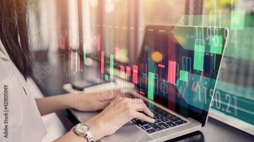 Billede på lærred Businesswoman trader using laptop computer technology data analysis graph on for