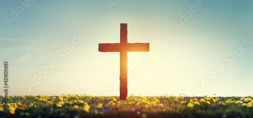 Fototapeta Cross on spring meadow religion and faith obraz