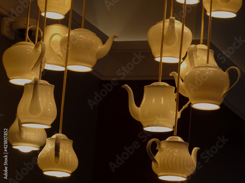 Fototapeta Low Angle View Of Illuminated Light Bulb Hanging From Ceiling obraz