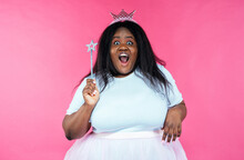 Image Of A Beautiful Woman Posing In A Fairy Costume On A Pink Background