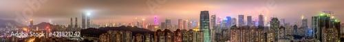 Fototapeta Panoramic View Of Illuminated Buildings Against Sky In City obraz