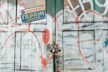 Close-up Of Graffiti On Garage Door