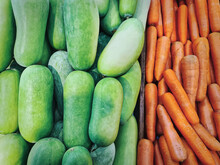 Full Frame Background Of Fresh Green Water Gourds And Orange Carrots