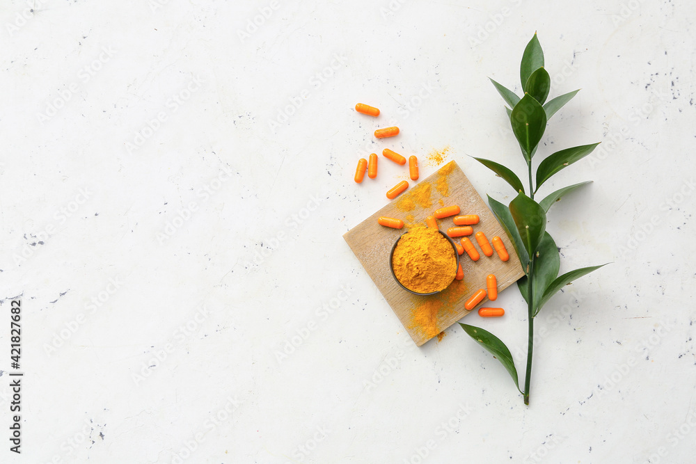 Fototapeta Turmeric pills and bowl with powder on light background - obraz na płótnie
