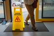 Yellow warning sign wet floor in shop.