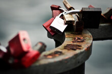 Close-up Of Padlocks On Rusty Metal