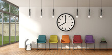 Clock Above Empty Colorful Chairs In Office