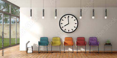 Photo Clock Above Empty Colorful Chairs In Office