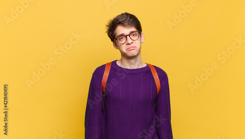 Photo young student boy feeling sad and whiney with an unhappy look, crying with a neg