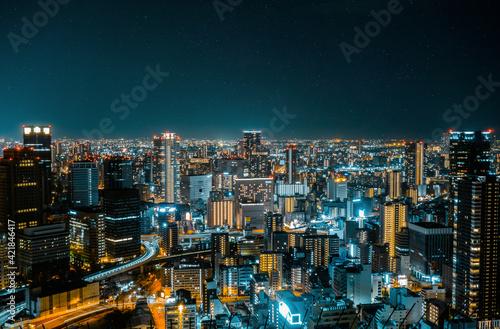 Illuminated Cityscape Against Sky At Night In Osaka