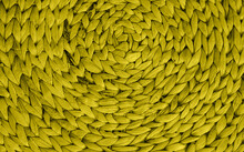 Wicker Basket Or Interior Decor Close-up. The Texture Of Weaving In A Circle. The Material Is Bamboo Or Reed.
