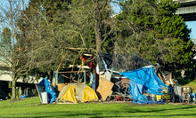 A Homeless People Camp At The Base Of A Bridge Over The Willamette River In Portland Oregon