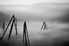 Cranes Against Sky In Foggy Weather
