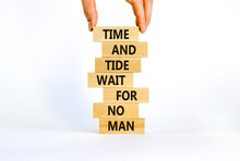 Time To Action Symbol. Wooden Blocks With Words Time And Tide Wait For No Man. Beautiful White Background. Businessman Hand. Business And Time To Action Concept. Copy Space.