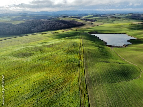 Foto Scenic View Of Agricultural Field Against Sky