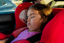 Closeup Shot Of A Cute Girl Sleeping In The Car