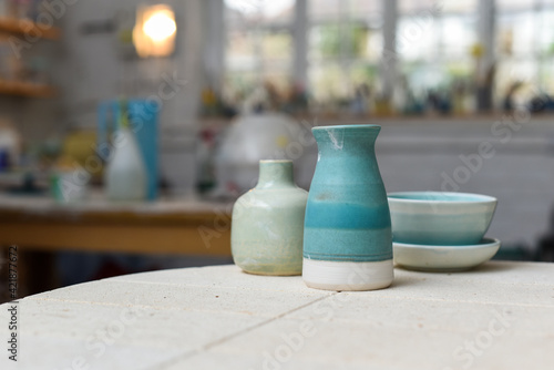 Tela Collection of finished ceramics products made from clay by hand displayed on a k