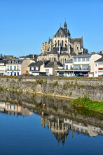 River In The Town Of Mayenne With Notre-Dame Basilica , Commune In The Mayenne Department In North-western France