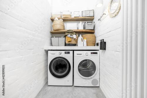 Fototapeta Domestic laundry room in white tones
