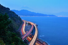 Lakeshore Road With Light Trails And Mt Fuji In The Distance, Yamanashi, Honshu, Japan