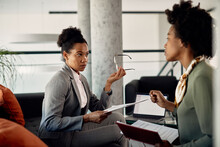 Black Female Business Mentor Talks About Work Assignments With A Trainee During The Meeting.