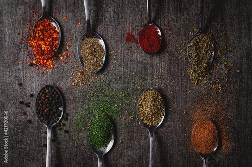 Fototapeta High Angle View Of Colorfull Seasoning On Floor obraz