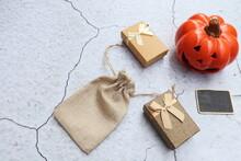 A Ceramic Halloween Jack O Lantern Pumpkin And Halloween Decoration On Crack Concrete Background