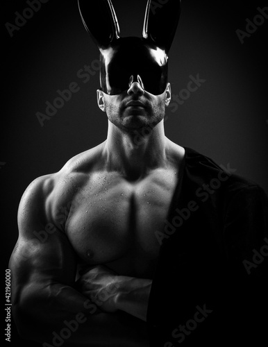 Portrait of naked shirtless muscular man with perfect built body wearing black g Fototapet