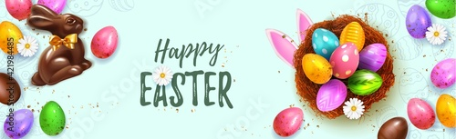 Fototapeta Festive Happy Easter Blue horizontal web banner. Realistic 3d Spring holiday. Easter colored eggs in nest with rabbit ears and chocolate bunny. Promotion sale and shopping template for Easter. obraz