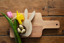 Easter Table Background. Spring Flowers With A Wooden Bunny And Easter Eggs