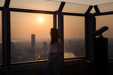 The Silhouette Of A Girl Standing On The Observation Deck And Looking At The Sunset